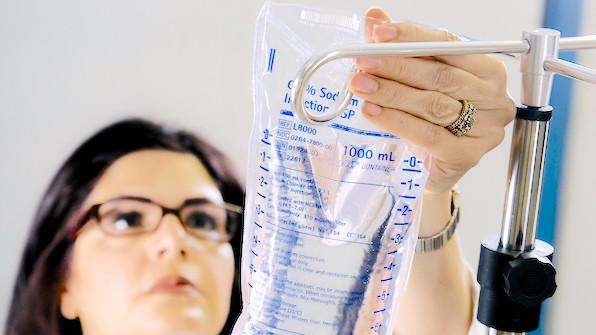 IV nurse hanging an iv bag