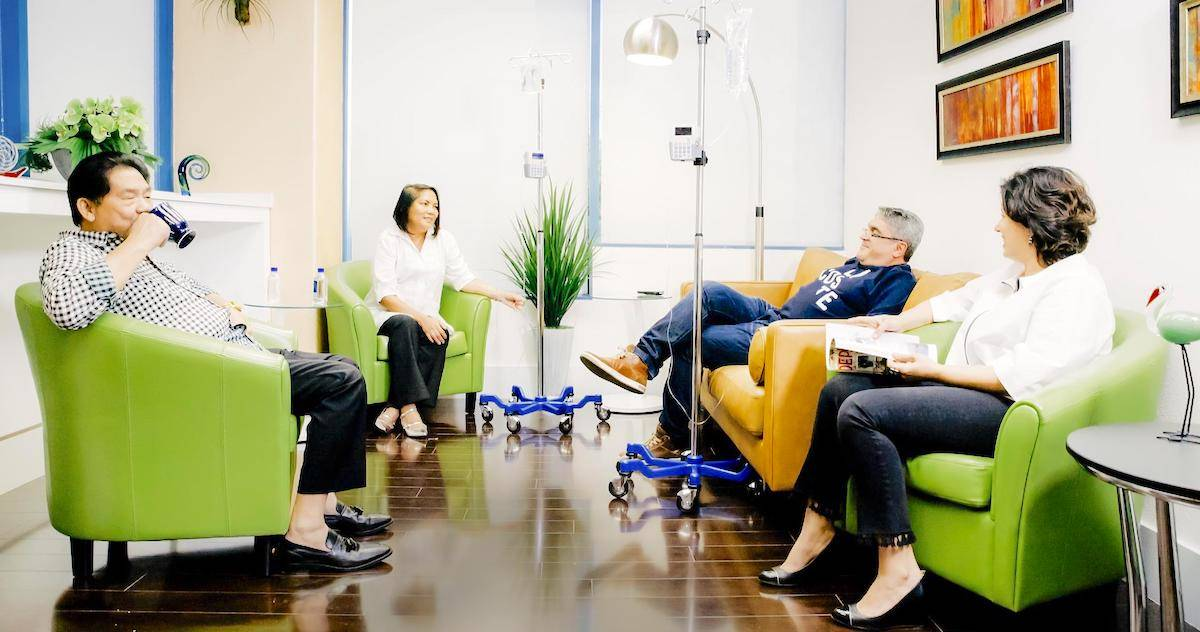 patients socializing in the community suite during infusion
